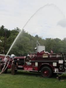 The Ray family's Ahrens Fox Pumper firetruck is a highlight of the Antique Engine Jamboree