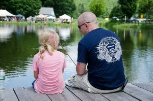 father and daughter fishing at HMM Independence Day Celebration