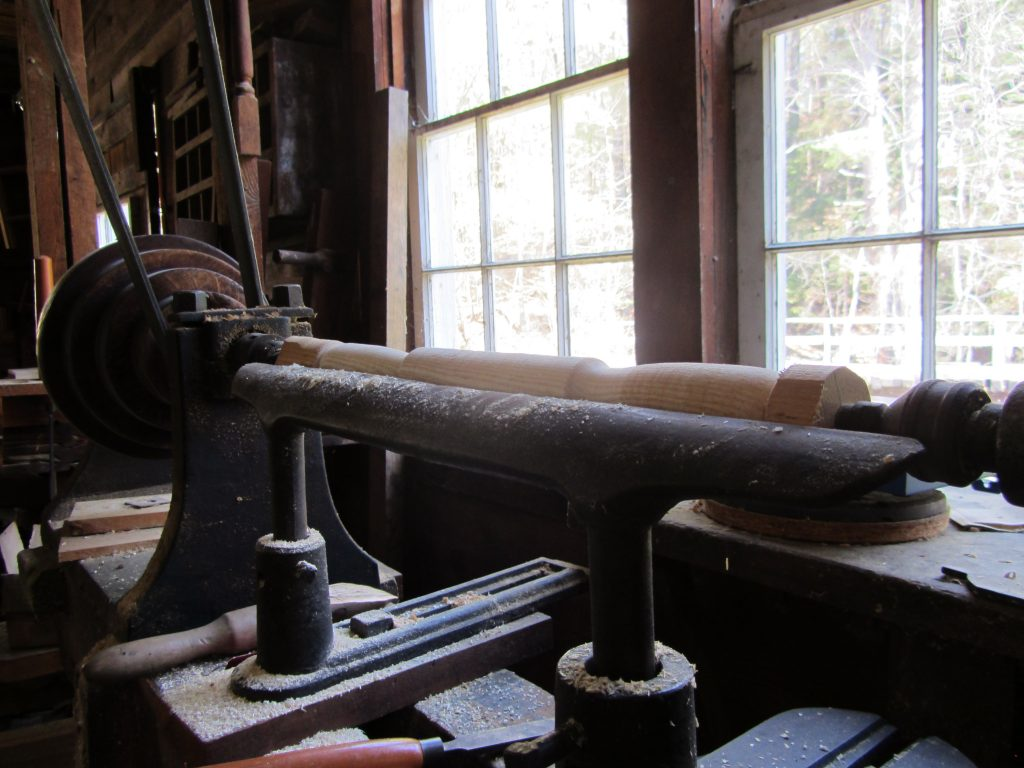 A wooden fram lathe at Hanford Mills Museum